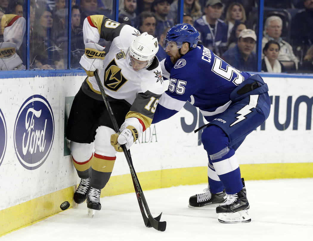 Vegas Golden Knights right wing Reilly Smith (19) gets around Tampa Bay Lightning defenseman Braydon Coburn (55) as they chase a loose puck during the first period of an NHL hockey game Thursday,  ...
