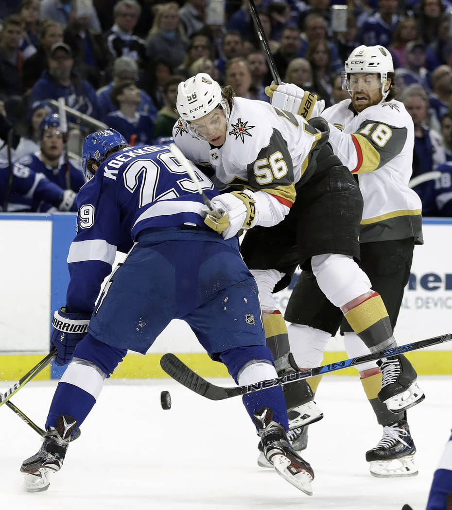Tampa Bay Lightning defenseman Slater Koekkoek (29) checks Vegas Golden Knights left wing Erik Haula (56) as he tries to cut into the offensive zone during the first period of an NHL hockey game T ...