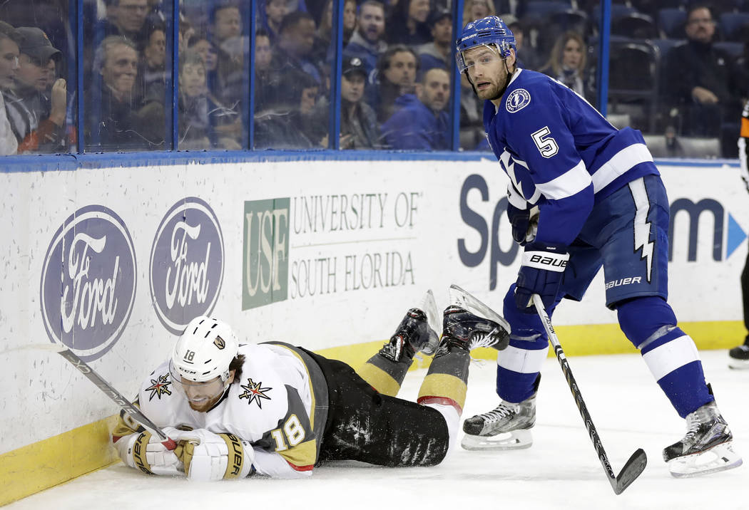 Tampa Bay Lightning defenseman Dan Girardi (5) sends Vegas Golden Knights left wing James Neal flying after a check during the first period of an NHL hockey game Thursday, Jan. 18, 2018, in Tampa, ...