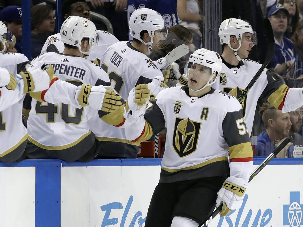 Vegas Golden Knights left wing David Perron (57) celebrates with the bench after scoring against the Tampa Bay Lightning during the second period of an NHL hockey game Thursday, Jan. 18, 2018, in  ...