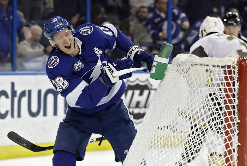 Tampa Bay Lightning left wing Ondrej Palat (18) celebrates after scoring against the Vegas Golden Knights during the second period of an NHL hockey game Thursday, Jan. 18, 2018, in Tampa, Fla. (AP ...