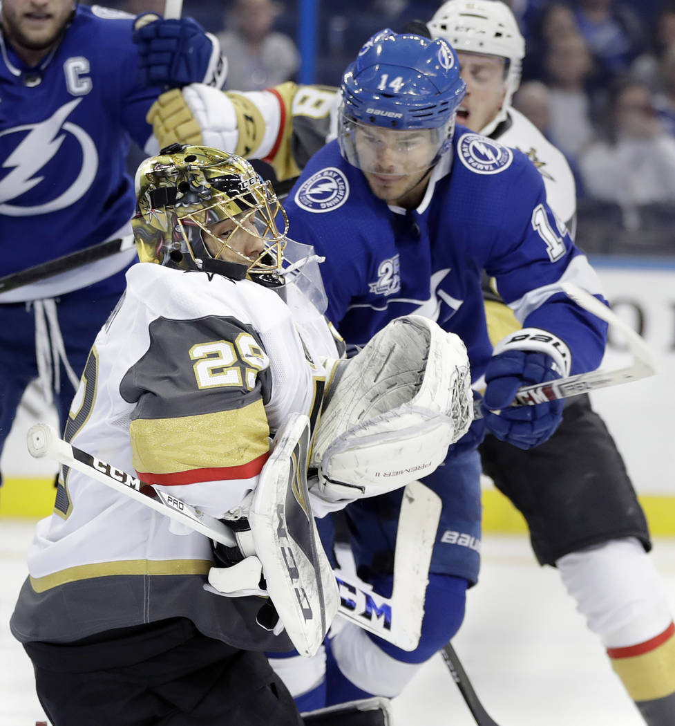 Tampa Bay Lightning left wing Chris Kunitz (14) tries to pick up a rebound after Vegas Golden Knights goaltender Marc-Andre Fleury (29) made a save on a shot during the second period of an NHL hoc ...