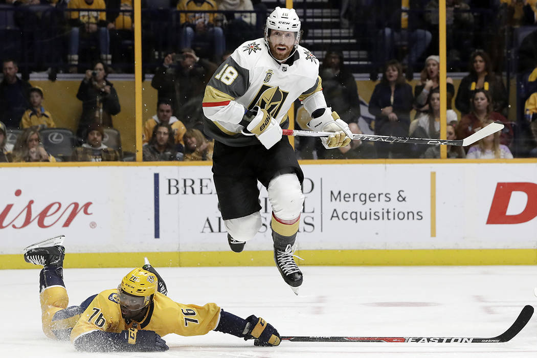 Vegas Golden Knights left wing James Neal (18) leaps over Nashville Predators defenseman P.K. Subban (76) in the third period of an NHL hockey game Tuesday, Jan. 16, 2018, in Nashville, Tenn. The  ...