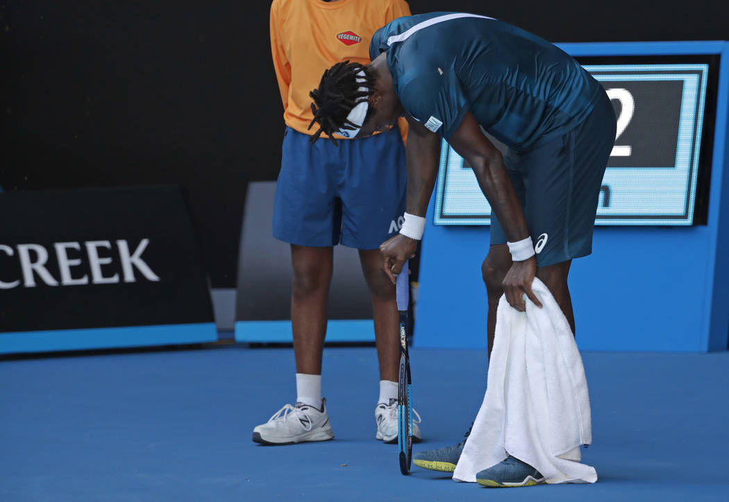 France's Gael Monfils bends over while playing Serbia's Novak Djokovic during their second round match at the Australian Open tennis championships in Melbourne, Australia, Thursday, Jan. 18, 2018. ...