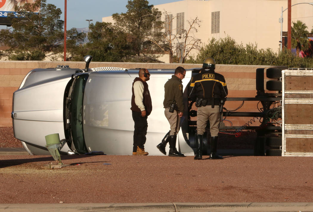 Metro Police officers investigate a crash after a semitrailer overturned on Las Vegas Boulevard South at Russell Road on Thursday Jan. 18, 2017, in Las Vegas. (Bizuayehu Tesfaye/Las Vegas Review-J ...