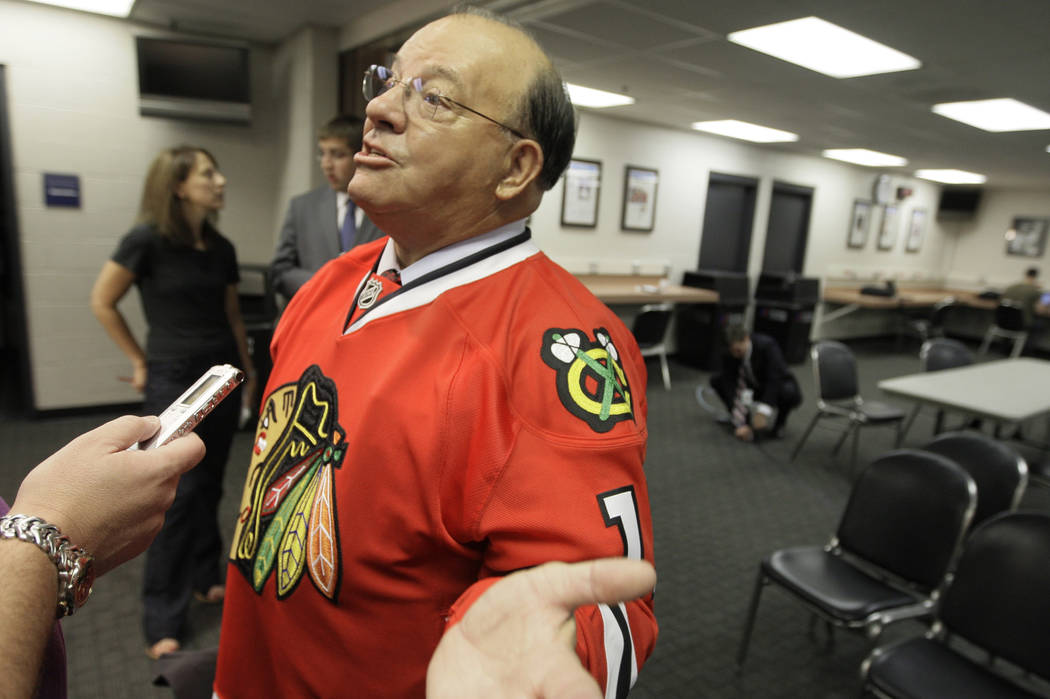 Eleven-time Stanley Cup champion Scotty Bowman answers questions after he was introduced as the new senior advisor for hockey operations for the Chicago Blackhawks on Thursday, July 31, 2008. (AP  ...