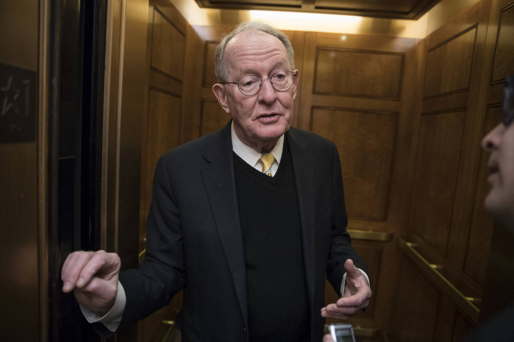 Sen. Lamar Alexander, R-Tenn., chairman of the Senate Health, Education, Labor, and Pensions Committee, pauses for a reporter's question at the Capitol in Washington, as Congress moves closer to t ...