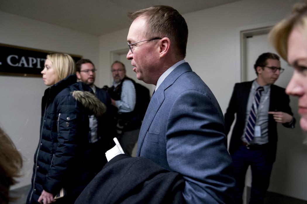 Budget Director Mick Mulvaney arrives on Capitol Hill in Washington, Thursday, Jan. 18, 2018. (AP Photo/Andrew Harnik)