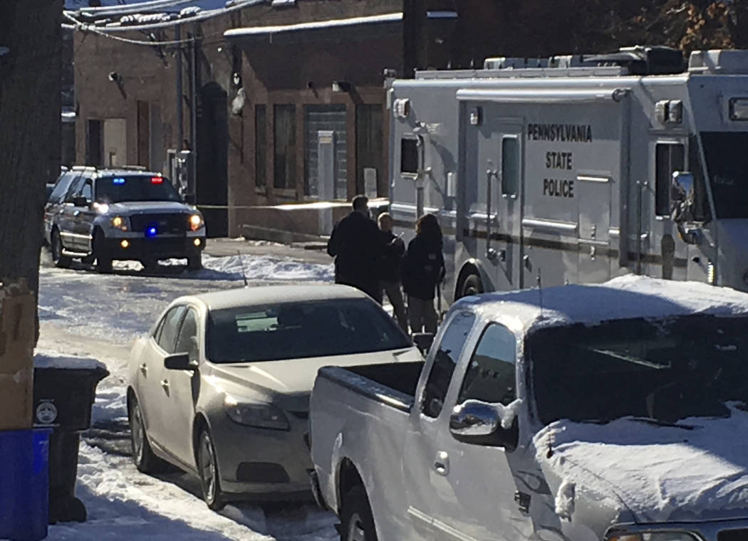 Law enforcement personnel stand near the scene of a shooting Thursday Jan. 18, 2018 in Harrisburg, Pa. The mayor of Harrisburg says a U.S. marshal is dead after being shot while serving an arrest  ...