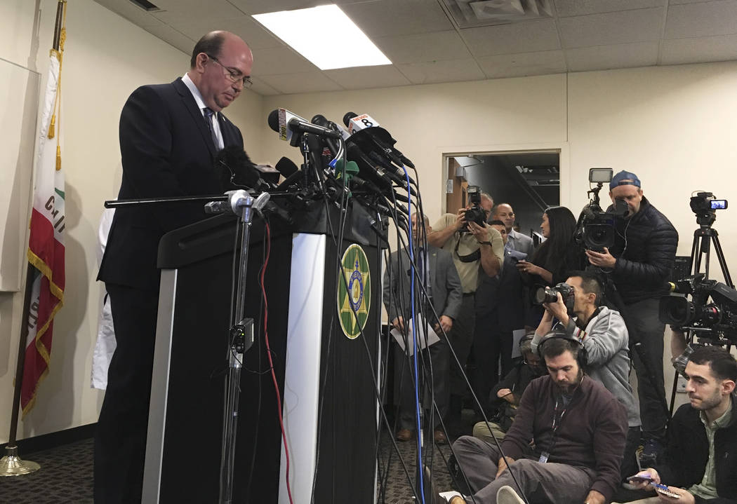 Riverside County Sheriff's Capt. Greg Fellows speaks with reporters during a news conference in Perris, Calif. on Jan. 16, 2018. A 17-year-old girl called police after escaping from her family's h ...