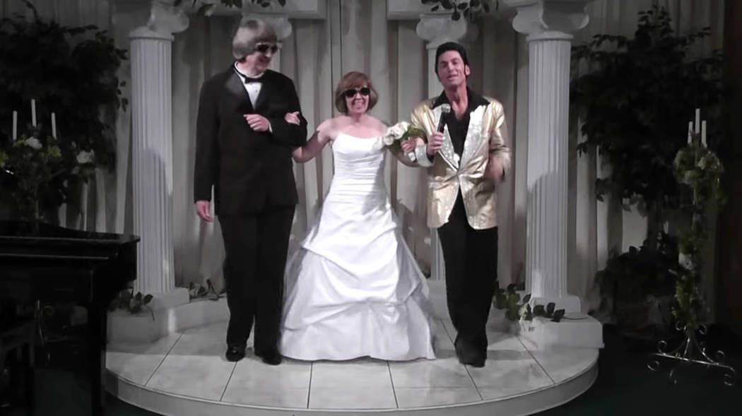 David Allen Turpin, left, and his wife, Louise Anna Turpin, right, celebrate a renewal of their wedding vows with Elvis impersonator Kent Ripley in Las Vegas on Oct. 29, 2011. (A Elvis Chapel via AP)