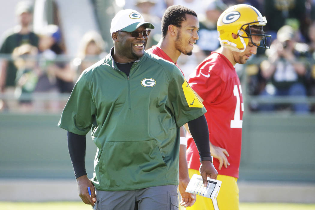 Green Bay Packers offensive coordinator Edgar Bennett watches a drill during NFL football training camp Thursday, July 30, 2015, in Green Bay, Wis. (AP Photo/Morry Gash)