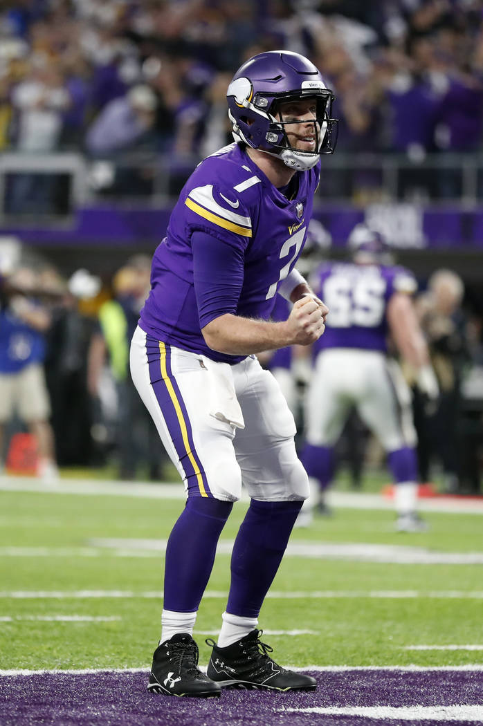 Minnesota Vikings quarterback Case Keenum (7) celebrates a touchdown by running back Latavius Murray during the first half of an NFL divisional football playoff game against the New Orleans Saints ...