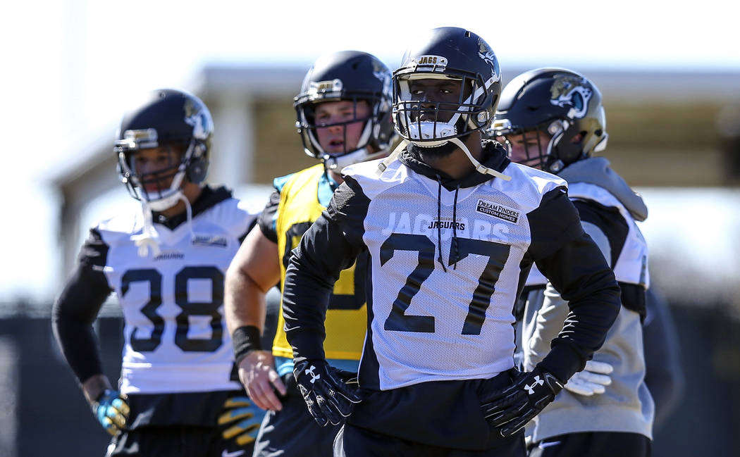 Jacksonville Jaguars running back Leonard Fournette (27) takes part in a drill during an NFL football practice in Jacksonville, Fla., Thursday, Jan. 18, 2018. (AP Photo/Gary McCullough)