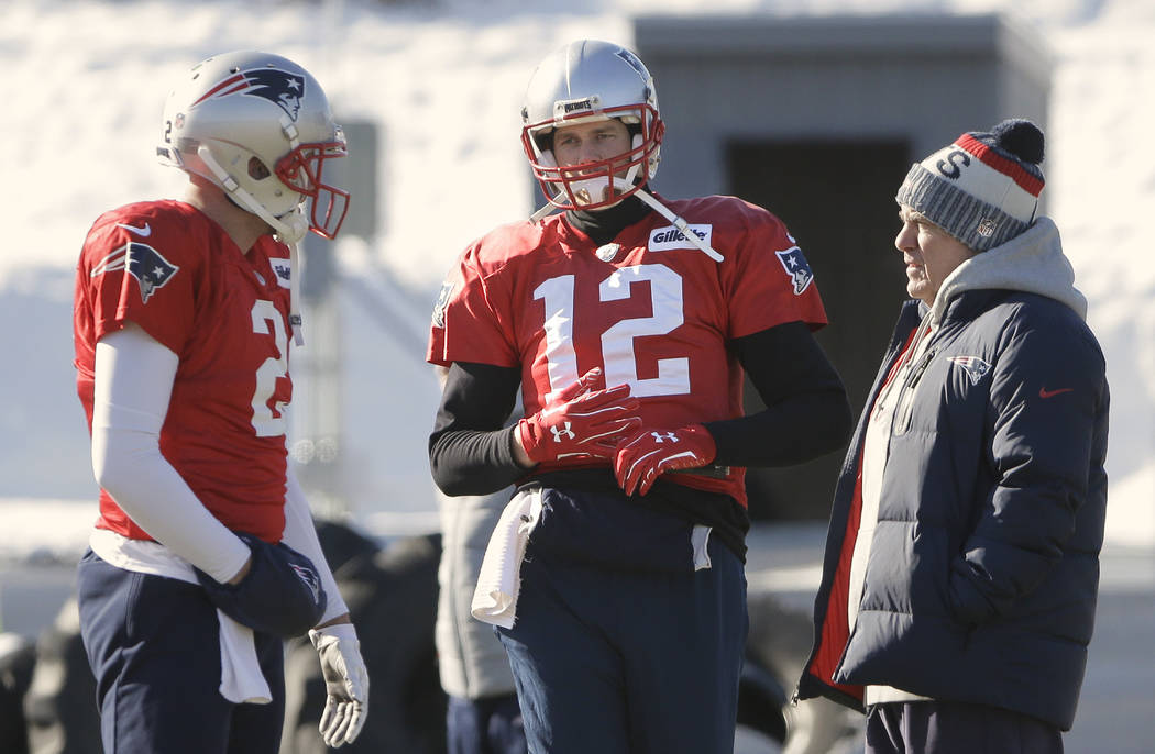 New England Patriots quarterbacks Brian Hoyer, left, and Tom Brady, center, stand with head coach Bill Belichick, right, during an NFL football practice, Thursday, Jan. 18, 2018, in Foxborough, Ma ...