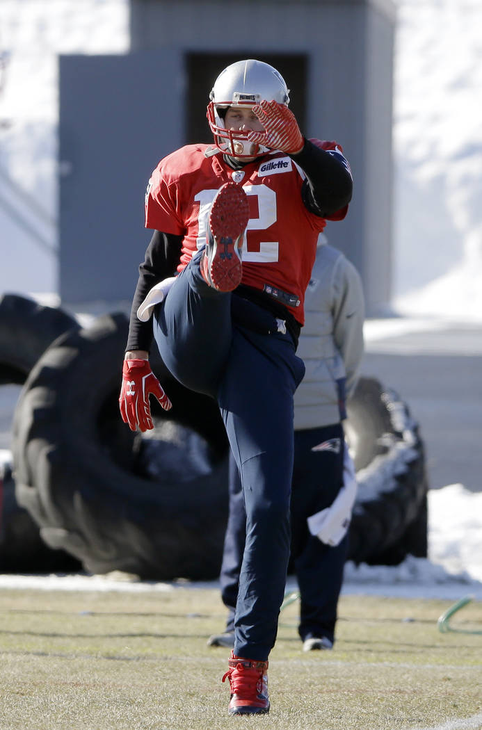 New England Patriots quarterback Tom Brady warms up on the field during an NFL football practice, Thursday, Jan. 18, 2018, in Foxborough, Mass. The Patriots are to host the Jacksonville Jaguars in ...