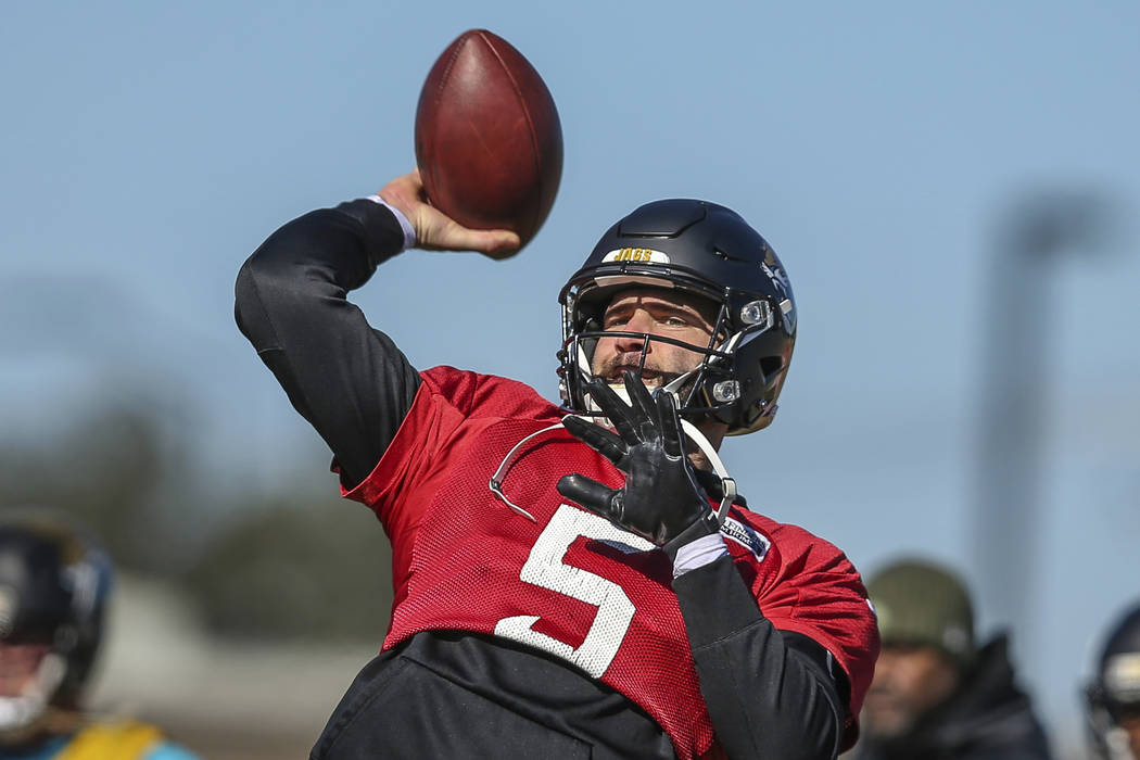 Jacksonville Jaguars quarterback Blake Bortles (5) takes part in a drill during an NFL football practice in Jacksonville, Fla., Thursday, Jan. 18, 2018. (AP Photo/Gary McCullough)