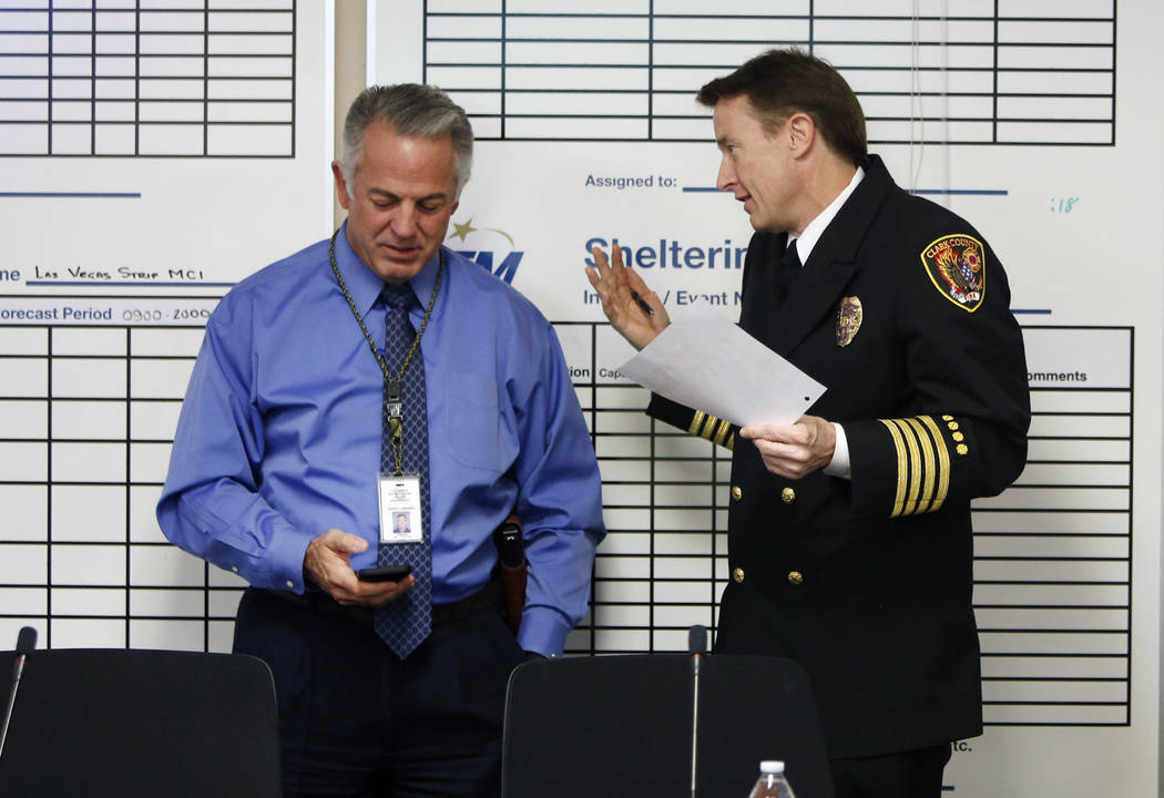 Clark County Sheriff Joe Lombardo, left, and Deputy Fire Chief John Steinbeck chat prior to the start of the Nevada Homeland Security Commission meeting on Monday, Jan. 29, 2018, in Las Vegas. (Bi ...