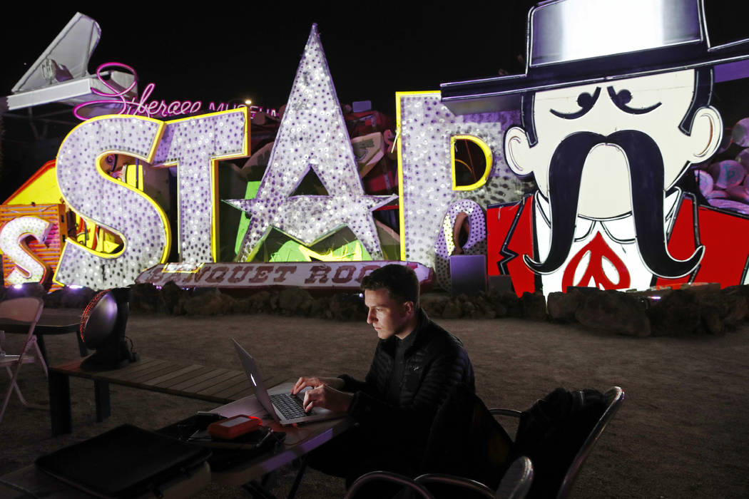 In this Jan. 24, 2018, photo, digital artist and designer Craig Winslow works on an exhibit at the Neon Museum in Las Vegas. Starting this week, visitors will be able to see many of the city's cla ...