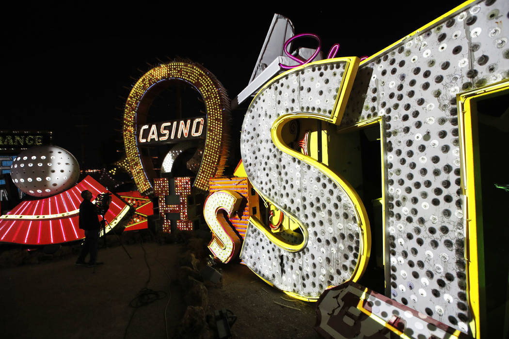 In this Jan. 24, 2018, photo a videographer shoots video of an exhibit at the Neon Museum in Las Vegas. Starting this week, visitors will be able to see many of the city's classic neon signs just  ...