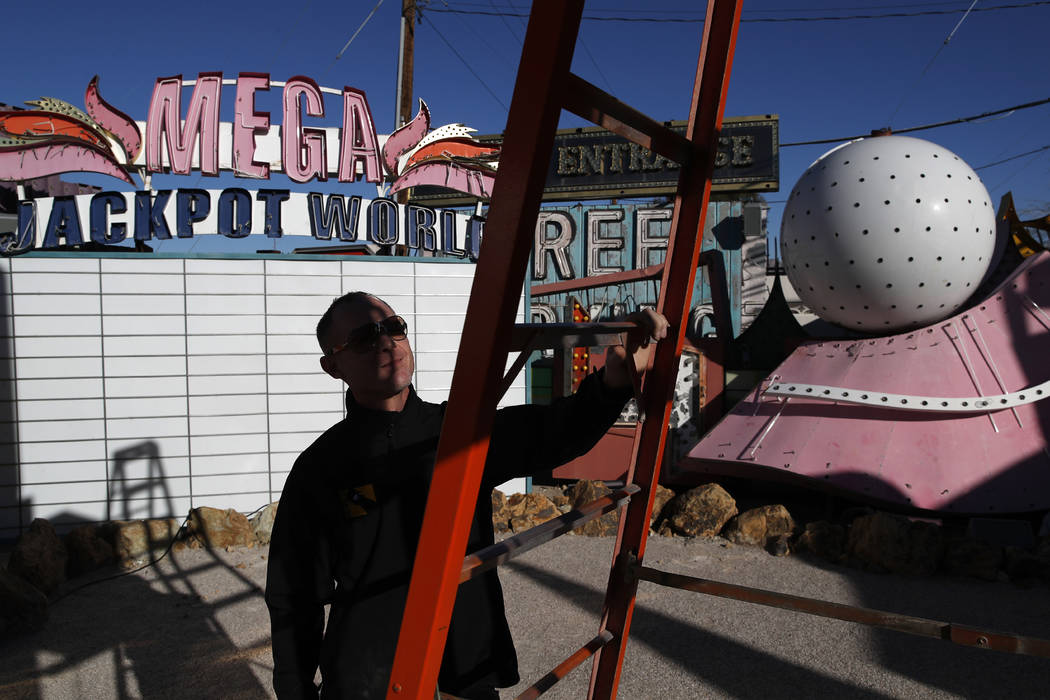In this Jan. 23, 2018, photo, John Humphries works on an exhibit at the Neon Museum in Las Vegas. Starting this week, visitors will be able to see many of the city's classic neon signs just like t ...