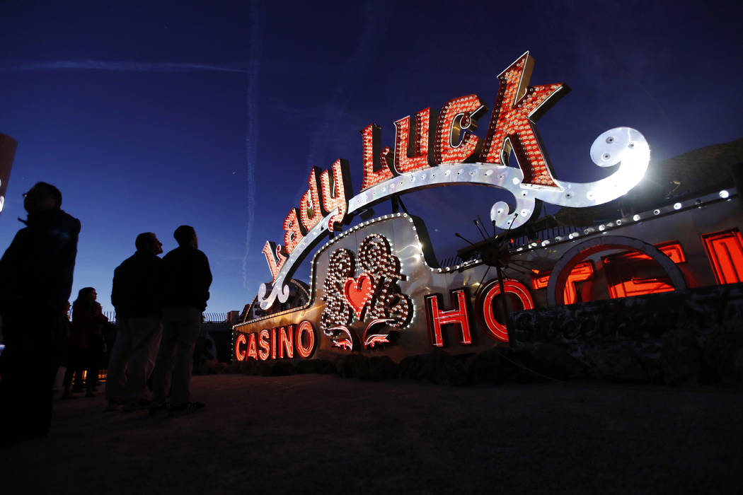 In this Jan. 24, 2018, photo, projectors light up non-working neon signs at an exhibit at the Neon Museum in Las Vegas. Starting this week, visitors will be able to see many of the city's classic  ...