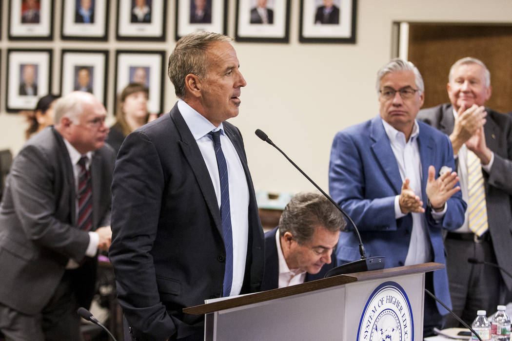 Thom Reilly, the newly appointed chancellor of the Nevada System of Higher Education, is applauded by the Board of Regents at a Board of Regents meeting in the NSHE office in Las Vegas on Monday,  ...