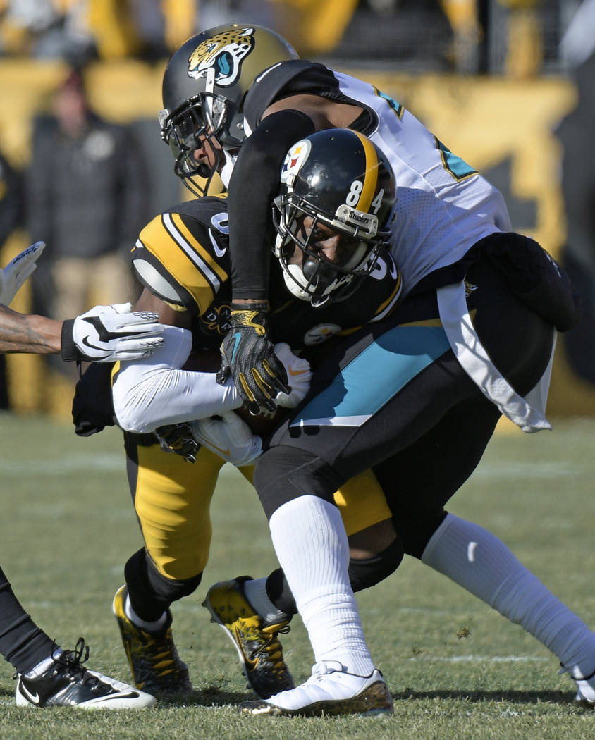 Pittsburgh Steelers wide receiver Antonio Brown (84) is tackled after making a catch by Jacksonville Jaguars cornerback Jalen Ramsey (20) during the first half of an NFL divisional football AFC pl ...