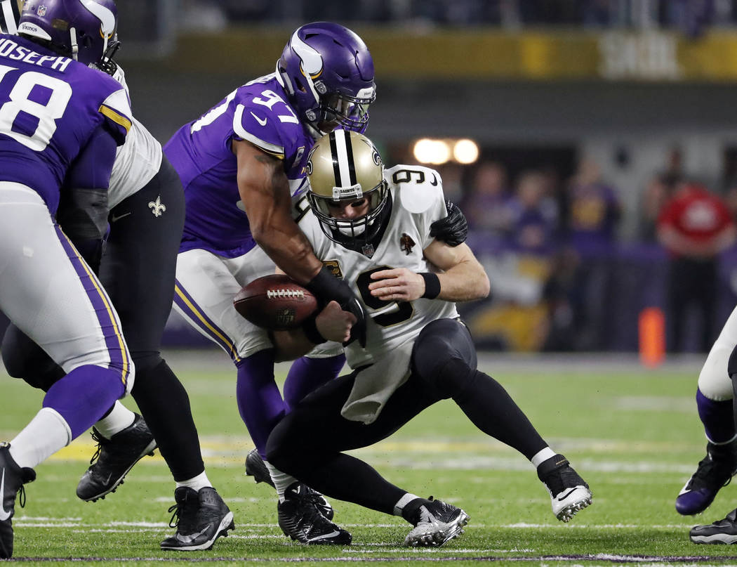 Minnesota Vikings defensive end Everson Griffen (97) knocks the ball away as he sacks New Orleans Saints quarterback Drew Brees (9) during the first half of an NFL divisional football playoff game ...