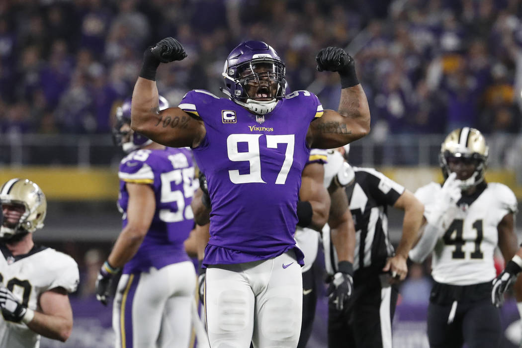 Minnesota Vikings defensive end Everson Griffen (97) celebrates a sack on New Orleans Saints quarterback Drew Brees (9) during the first half of an NFL divisional football playoff game in Minneapo ...