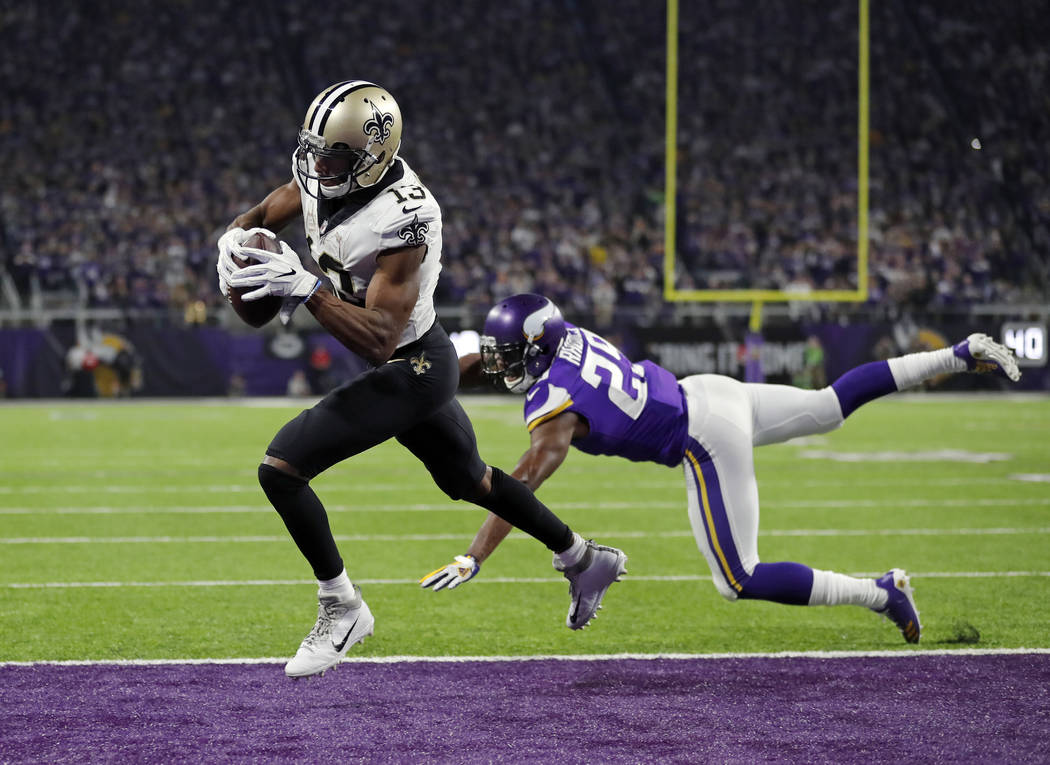 New Orleans Saints wide receiver Michael Thomas (13) make s a catch for a touchdown behind Minnesota Vikings cornerback Xavier Rhodes (29) during the second half of an NFL divisional football play ...