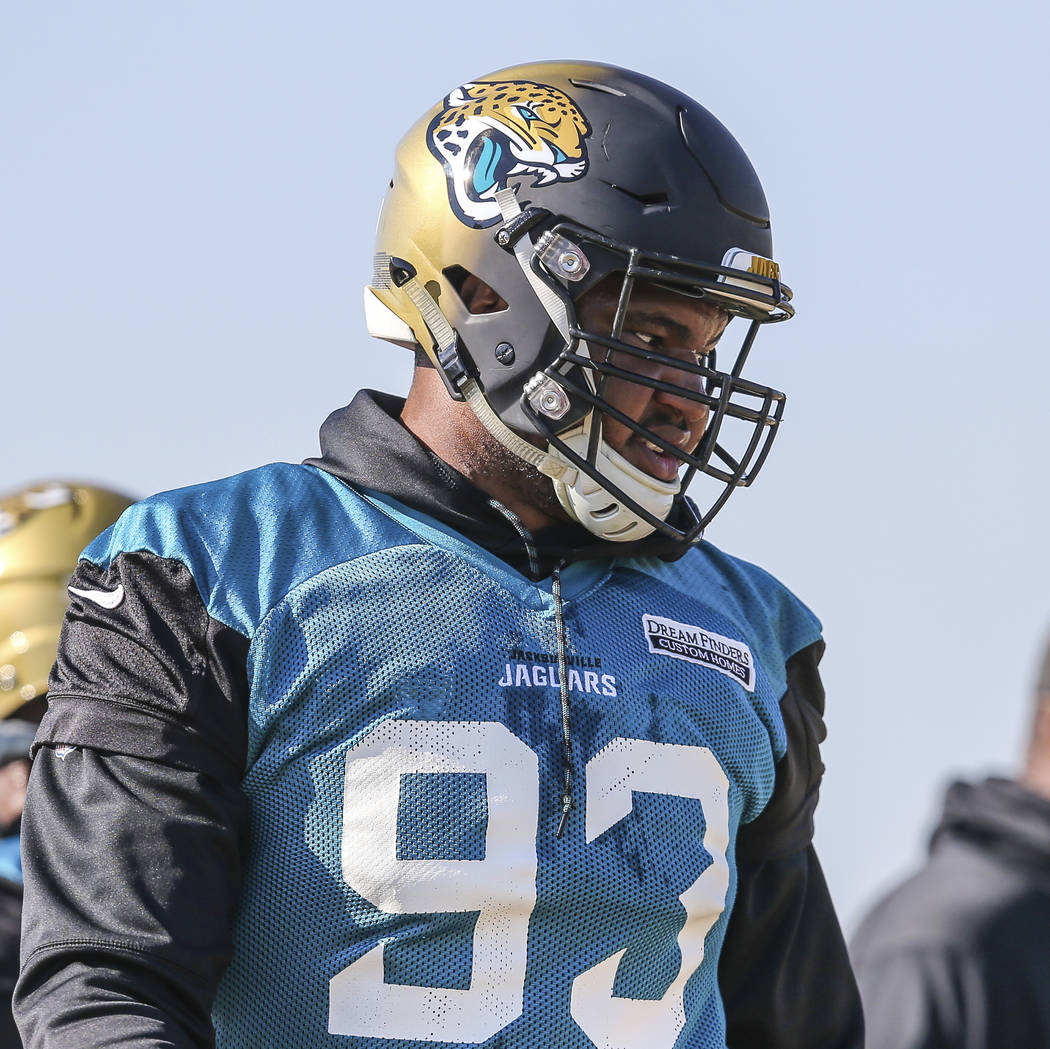 Jacksonville Jaguars defensive end Calais Campbell (93) lines up for a drill during an NFL football practice in Jacksonville, Fla., Friday, Jan. 19, 2018. (AP Photo/Gary McCullough)