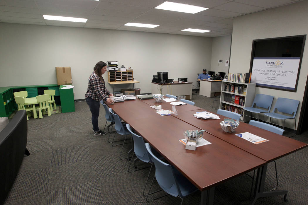 Vikki Andrews, and administrative secretary with Clark County Department of Juvenile Justice Services, moves into the new location for The Harbor juvenile assessment center Friday, Jan. 19, 2018.  ...