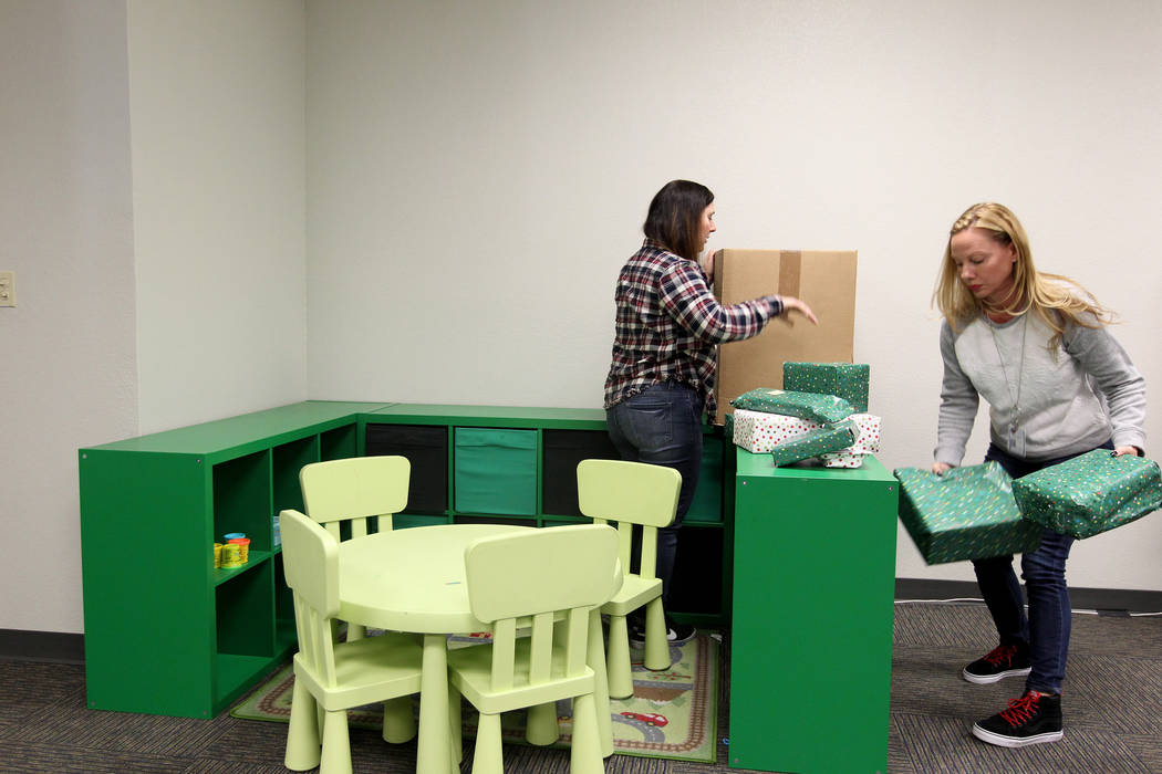 Clark County Department of Juvenile Justice Services employees Vikki Andrews, left, and Cheryl Wright move into the new location for The Harbor juvenile assessment center Friday, Jan. 19, 2018. Th ...