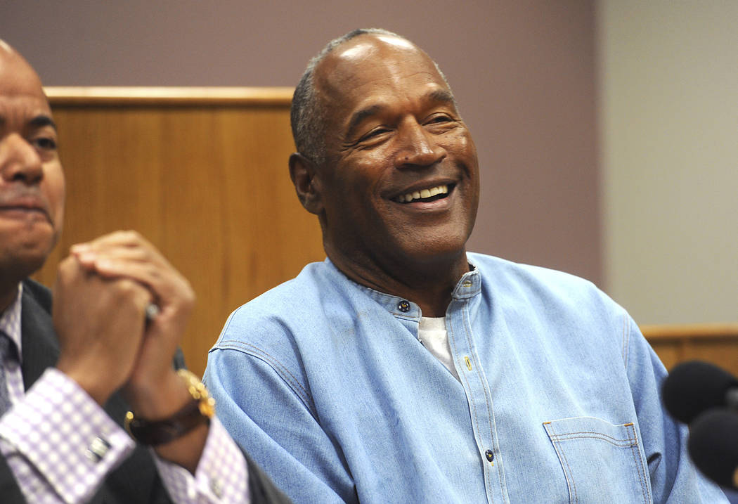 Former NFL football star O.J. Simpson laughs as he appears via video for his parole hearing at the Lovelock Correctional Center in Lovelock, July 20, 2017. Simpson enjoys living in Las Vegas, and  ...