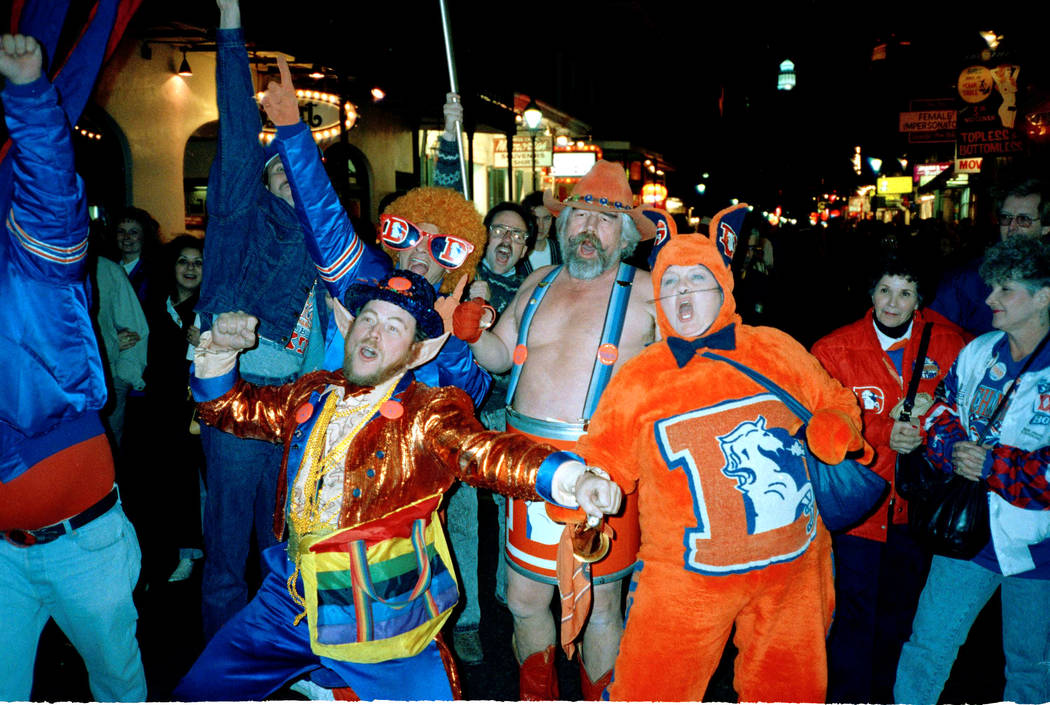"Unoffical cheerleaders for the Denver Broncos make their presence known on Bourbon Street in New Orleans Thursday, Jan. 26, 1990. Rocky ""Leprechaun"" Brougham, left, ""Str ..."