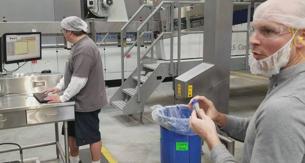 David VanderKlipp, production manager for Premium Waters' Las Vegas Valley plant, explains how his company makes plastic water bottles. The company's clients include Wal-Mart and local casinos. (W ...