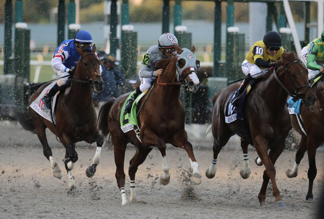 Jockey Victor Espinoza rides California Chrome (12) out of the starting gate in the inaugural running of the $12 million Pegasus World Cup horse race at Gulfstream Park, Saturday, Jan. 28, 2017, i ...