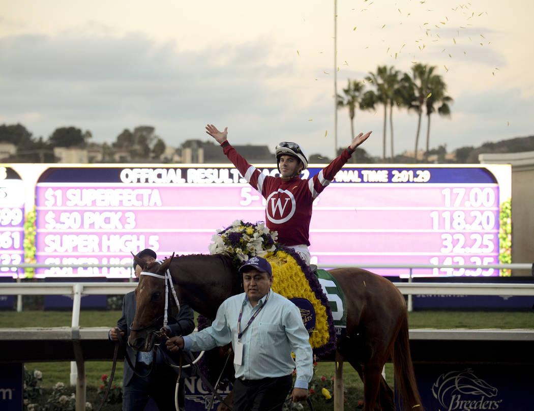 Florent Geroux celebrates after riding Gun Runner to victory in the Classic horse race during the Breeders' Cup, Saturday, Nov. 4, 2017, in Del Mar, Calif. (AP Photo/Denis Poroy)