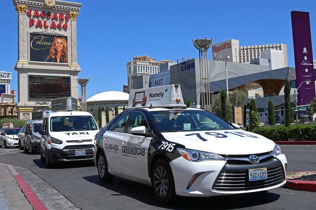 Cab drivers pull into the taxi pick up lane at Caesars Palace hotel-casino in Las Vegas, Thursday, April 20, 2017. Gabriella Benavidez Las Vegas Review-Journal