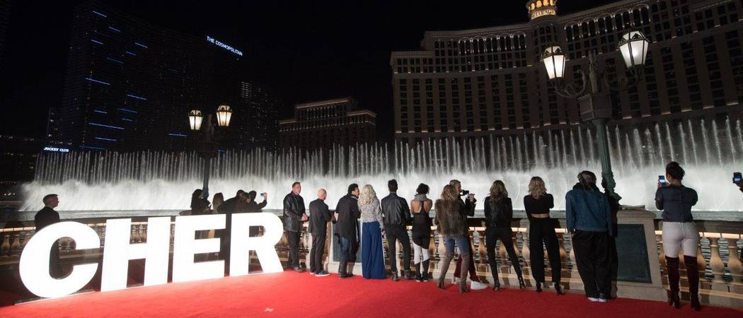 "A look at Cher and a group of MGM Resorts International and AEG Live executives at the Bellagio Fountain show as it plays ""Believe"" on Wednesday, Jan. 17, 2018. (Tom Donoghue)"