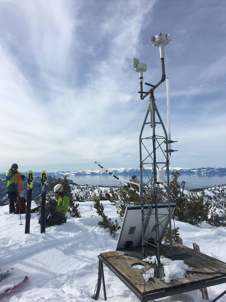 An undated photo shows scientists from the Desert Research Institute at the Slide Mountain weather station, which overlooks Lake Tahoe near Reno. Siani Nau