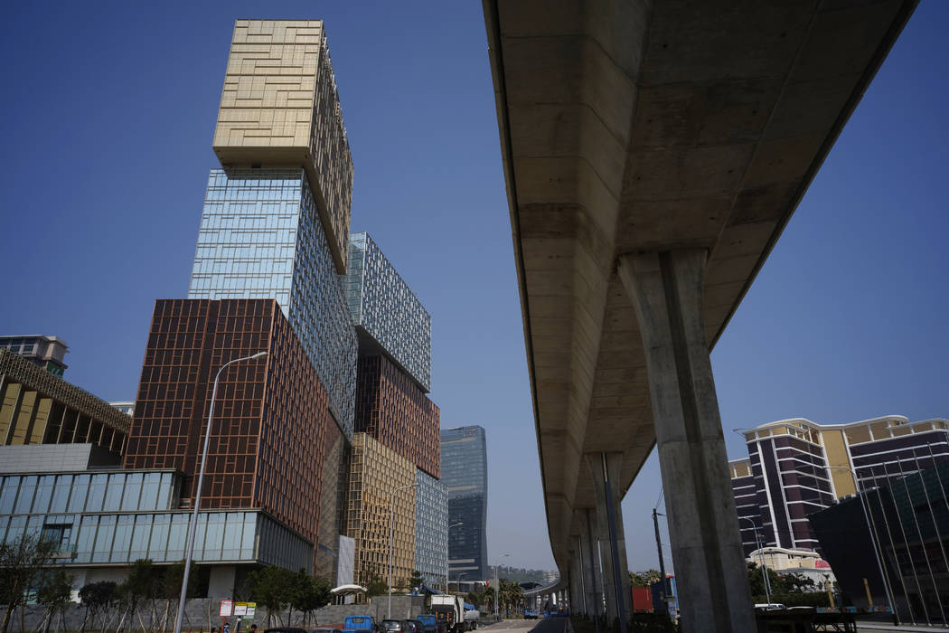 MGM Cotai Resort, left, is seen in Macau Tuesday, Feb.13, 2018. MGM Resorts is opening a lavish multibillion-dollar casino resort in Macau, in the latest big bet by foreign gambling companies on t ...