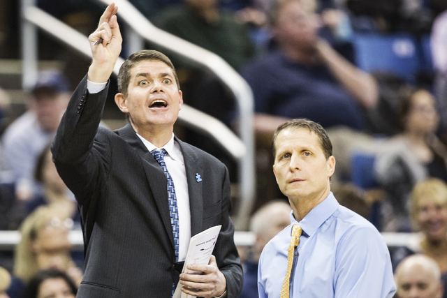 UNR assistant coach Dave Rice, left, calls out a defensive play flanked by head coach Eric Musselman during the Wolf Pack's home matchup with UNLV on Wednesday, Feb. 8, 2017, at the Lawlor Events  ...