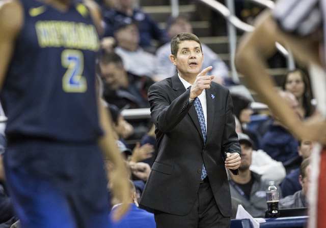 UNR assistant coach Dave Rice instructs Wolf Pack players during their home matchup with UNLV on Wednesday, Feb. 8, 2017, at the Lawlor Events Center, in Reno. Rice was a player on the 1990 UNLV N ...