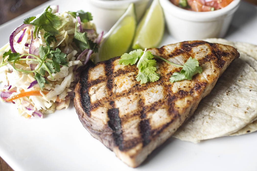 Grilled swordfish with deconstructed tacos, cabbage, shaved onions, pico de gallo, cilantro lime salt, guacamole, radish, chipotle creme and corn tortillas at Hamptons on Thursday, Jan. 25, 2018,  ...