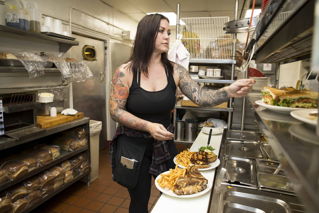 Lindsay Stevens checks on a food order at the Coffee Cup in Boulder City, Thursday, Feb. 8, 2018. Lindsay is the daughter of the Coffee Cup owners Al and Carri Stevens. Erik Verduzco Las ...