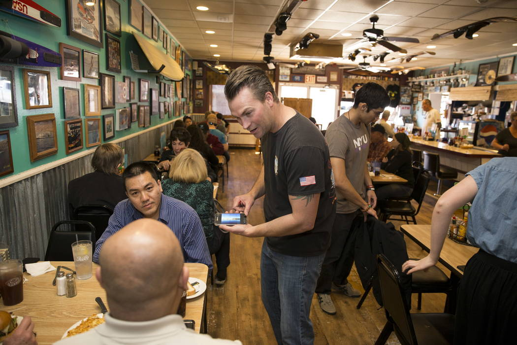 Terry Stevens speaks with customers at The Coffee Cup in Boulder City, Thursday, Feb. 8, 2018. Terry is the son of The Coffee Cup owners Al and Carri Stevens. Erik Verduzco Las Vegas Review-Journa ...