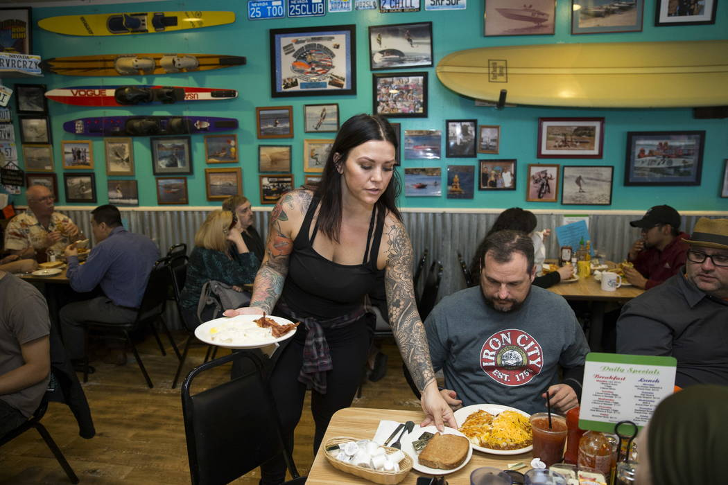 Lindsay Stevens delivers food to customers at the Coffee Cup in Boulder City, Thursday, Feb. 8, 2018. Lindsay is the daughter of the Coffee Cup owners Al and Carri Stevens. Erik Verduzco ...