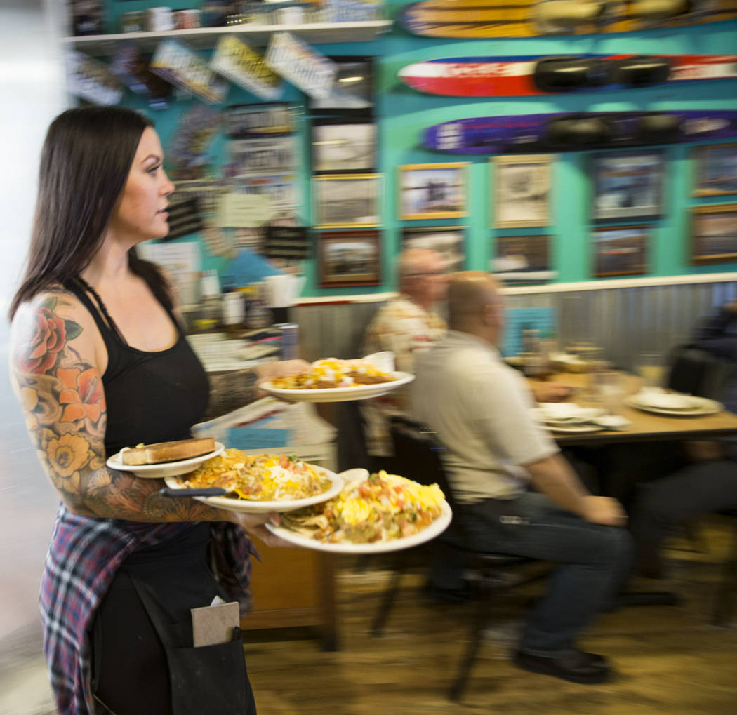Lindsay Stevens delivers food to customers at theCoffee Cup in Boulder City, Thursday, Feb. 8, 2018. Lindsay is the daughter of theCoffee Cup owners Al and Carri Stevens. Erik Verduzco ...